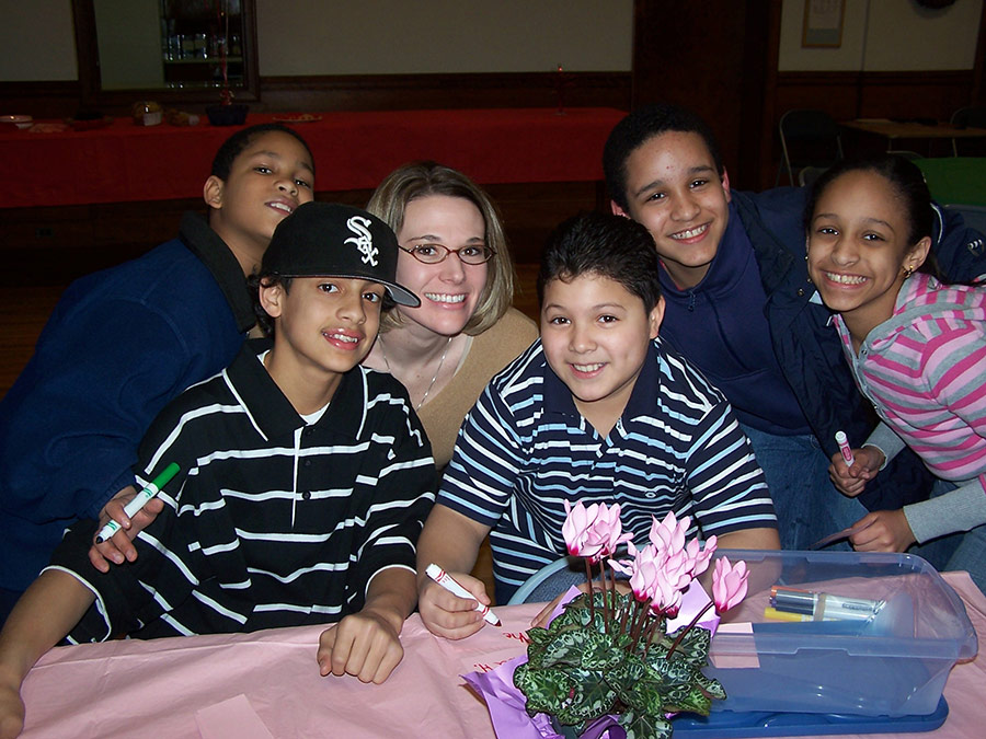 Heather Ruple serving with the young Miguel Men at San Miguel School Providence, RI